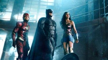 The Flash (Ezra Miller) Batman (Ben Affleck) and Wonder Woman (Gal Gadot) in Justice League.