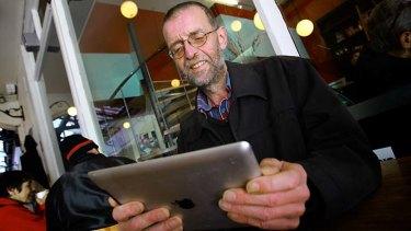 Stan Thomas playing on his ipad