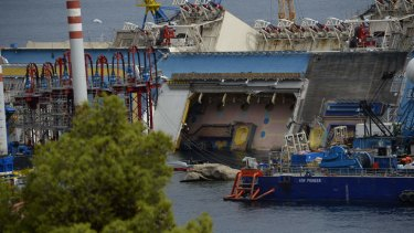 The wreck of Italy's Costa Concordia cruise ship near the harbour of Giglio Porto. Salvage workers will attempt to raise the cruise ship in the largest and most expensive maritime salvage operation in history.