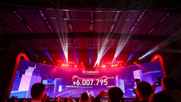 China's Singles Day online shopping festival just past midnight with a screen showing the transaction volume in Shenzhen in southern China's Guangdong province on November 11. China's online shoppers turn over tens of billions of dollars annually and it is a ready way to access the world's richest market.
