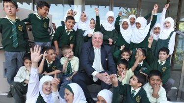 Dr Ray Barrett with students at the Malek Fahd School in Greenacre.