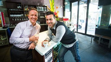 Declan Jacobs (left), a founder of the Suspended Coffee Society Melbourne, with Petros Prokopis, manager of Amici Bakery in Prahran, one of the first to get involved.