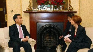 Wang Yang, left, secretary of the Guangdong Committee of the Communist Party of China, talks with Australian Prime Minister Julia Gillard at Kirribilli House.