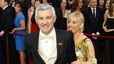 Singing Glee's praises ... Baz Luhrmann and his wife Catherine Martin.