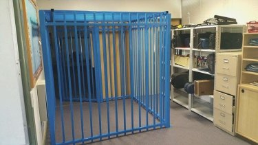 The metal pool fence structure at the centre of the ACT's withdrawal space crisis.