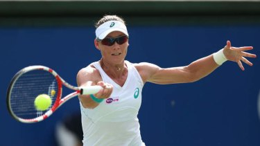 Digging deep: Samantha Stosur competes in the semi-final of the Japan Women's Open. She went on to win the final.