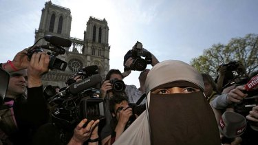 Kenza Drider, a French Muslim of North African descent, wears a niqab outside the Notre Dame Cathedral in Paris.