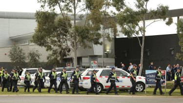 Police and paramedics  at the Metropolitan Remand Centre in Ravenhall where prisoners were rioting.
