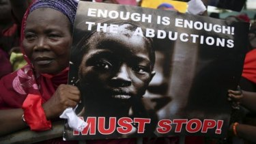 A woman holds a sign during a protest demanding the release of abducted secondary school girls from the remote village of Chibok, in Lagos May 5, 2014.