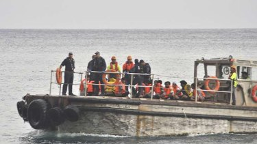 Rescued ... a barge carrying rescued suspected asylum seekers nears Christmas Island today.