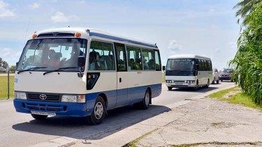 Asylum seekers are taken on a tour of Nauru.