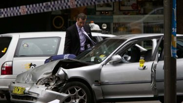 Police shot two boys after a stolen car was driven onto a footpath in Kings Cross early yesterday.