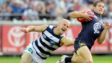 Gary Ablett collars Blue Aaron Joseph - one of his seven tackles for the match - but his 38-possession game did not impress coach Mark Thompson.
