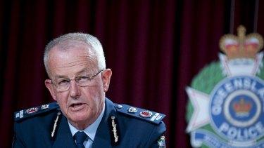 Queensland Police Commissioner, Bob Atkinson, announces news of the arrest.