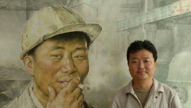 "North Korean artist Im Hyok with his work ""Break Time"" at the Mansudae Art Studio in Pyongyang."