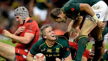 South Africa skipper Jean de Villiers scores a try.