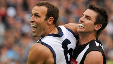 Brad Ottens battles Collingwood's Darren Jolly in the 2011 decider.