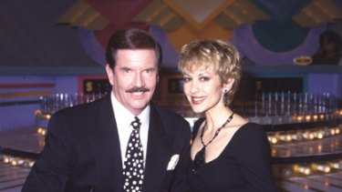 Adriana Xenides with John Burgess on the set of Wheel of Fortune.