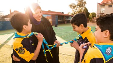 Proud Mum: Rasha Ahmed with her three sons Yahya, Younus and Dawoud Salman who were inducted into Australia's first ever all-Muslim cub scout group at the Australian International Academy's King Khalid campus (primary school) in Coburg on Tuesday.