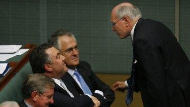 The former Prime Minister, John Howard, speaks to Joe Hockey and Malcolm Turnbull.