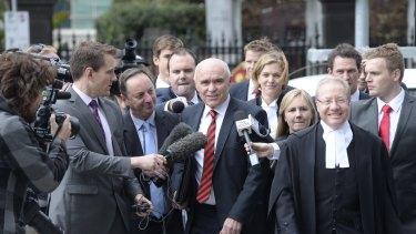 Essendon chairman Paul Little arrives at the court.