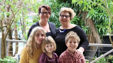 All together: Penny Sharpe, left, with partner Jo Tilly and children Jemima, 15, Pippi, 4 and Red, 10.
