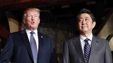 President Donald Trump, left, and Japanese PM Shinzo Abe. Mr Trump has spoken about the latest mass shooting in America.