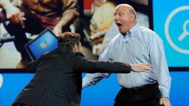 Microsoft CEO Steve Ballmer hugs host Ryan Seacres.