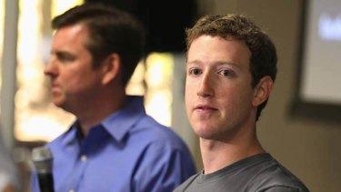 Skype CEO Tony Bates, left, and Facebook CEO Mark Zuckerberg hold a news conference at Facebook headquarters in Palo Alto, California.