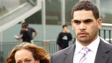 Melbourne Storm player Greg Inglis leaves the Sunshine Magistrates Court holding hands with his girlfriend Sally Robinson.