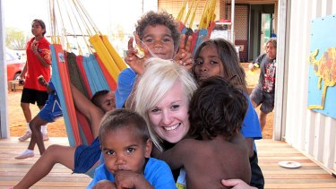 Hannah Newnham, education co-ordinator for the Gumala Aboriginal Corporation, with some of the children at the newly built learning centre in remote Western Australia.