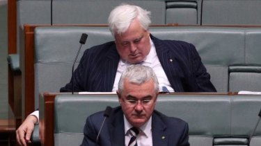 Clive Palmer rests his eyelids during question time, sitting behind fellow crossbench MP Andrew Wilkie.