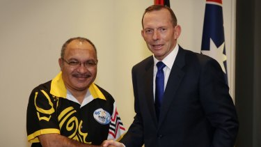 Then prime minister Tony Abbott meets PNG leader Peter O'Neill in September 2015.