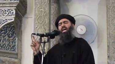 Abu Bakr al-Baghdadi delivering a sermon at a mosque in Iraq in 2014.