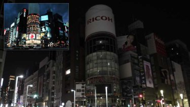 Lights out: Tokyo's famous landmarks are turning off the neon to conserve energy.