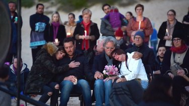 Justine's parents Maryan Heffernan, and John Ruszczyk, right, with their son Jason Ruszczyk and his wife Katarina Ruszczyk, left at Freshwater Beach during a vigil for their daughter following her shooting death.