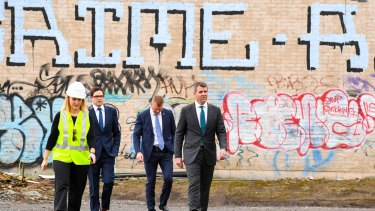NSW Premier Mike Baird (right) arrives at the goods yard in Rozelle on Thursday to announce the extension.