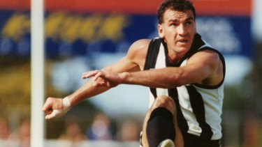 Darren Millane kicks the ball when Collingwood played Geelong at Kardinia Park March 1991.