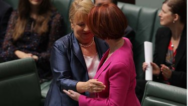 Disability Reform Minister Jenny Macklin and Prime Minister Julia Gillard embraces after introducing the NDIS in Parliament.