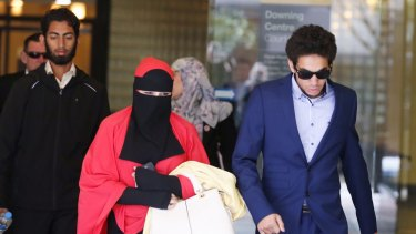 Mustafa Shiddiquzzaman, left, and Junaid Thorne, far right, leave the Downing Centre District Court during an appeal hearing on Wednesday.