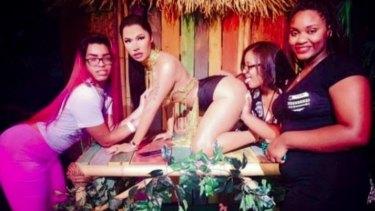 Female patrons get frisky with the waxwork of Nicki Minaj from Madame Tussauds Las Vegas.