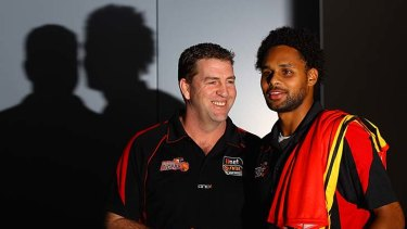 Welcome aboard: Melbourne Tigers coach Trevor Gleeson with star signing Patty Mills.