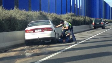 A man is taken into custody on the Hume Freeway in Melbourne's outer north after he crashed into a blockade of people's cars set up by police.