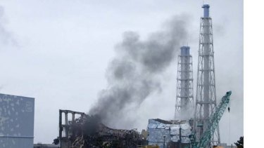 Smoke billows from the area of the No. 3 reactor of the Fukushima Daiichi nuclear power plant on Monday, March 21.