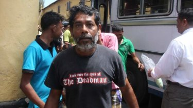 A man transferred to Sri Lankan custody arrives at court in Galle.