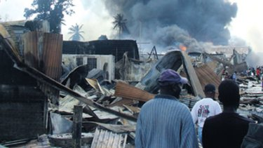 Fuelling friction in the Solomons...shops blaze in Honiara's Chinatown after a night of rioting in 2006