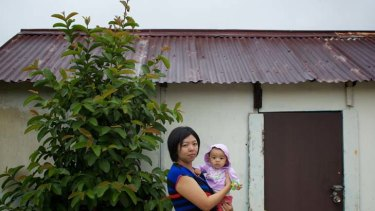 Sent home … Elly Sugianto with her 8-month-old daughter Zara. Elly was dismissed by her employer, Commonwealth Bank, after returning from maternity leave.