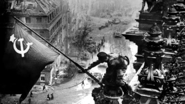 In the end, it fell mostly to the Soviets, pictured raising their flag over the Reichstag, Berlin, in 1945, to finish Hitler's dreams of empire.