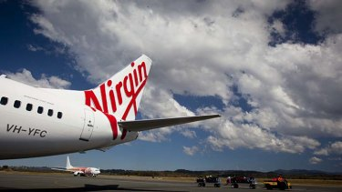 Tough times ... takeovers and trading conditions are hitting Virgin's bottom line.