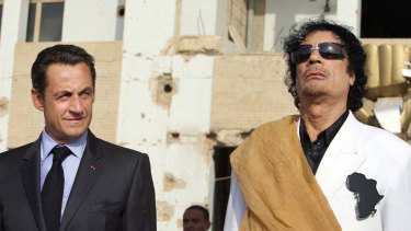 Finance ... Nicolas Sarkozy and Muammar Gaddafi in Tripoli in 2007.